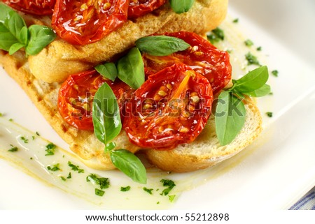 Delicious roasted cherry tomatoes with basil on bruschetta.