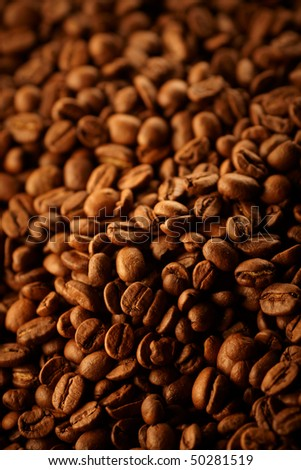 Delicious roasted coffee beans background,shallow focus