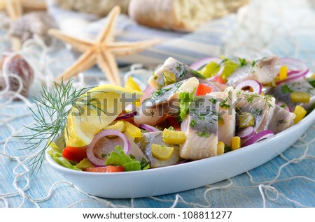 Delicious salad of salted fillets of white herring