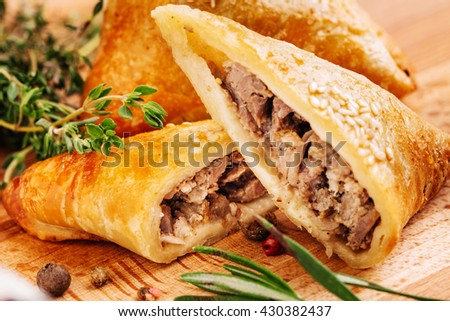 Delicious samosa pies with meat on plate. Menu, restaurant, recipe concept. Served in traditional oriental restaurant. Selected focus. #430382437