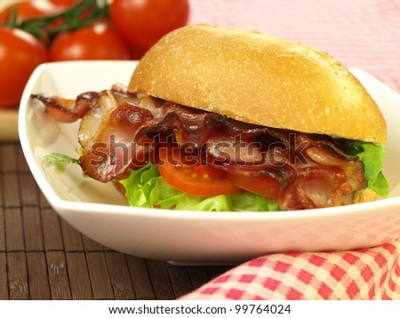 Delicious sandwich with bacon for a dinner