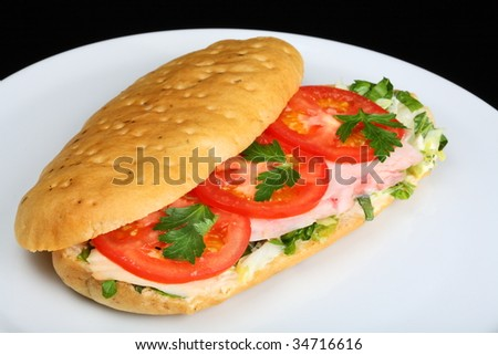 Delicious sandwich with tomatoes and chicken breast