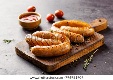 Delicious sausages grilled with tomato sauce. Selective focus
