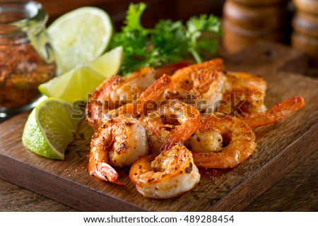 Shutterstock Delicious sauteed shrimp with cajun seasoning and lime on a maple plank.