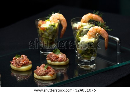 Delicious Shrimp Cocktail, Shrimp, avocado, fresh tomatoes, onions and cream cheese.