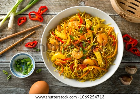 Delicious Singapore style noodles with curry, shrimp, bbq pork, carrots, red pepper, onion and scallions.