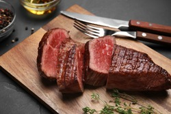 Delicious sliced beef tenderloin served on table, closeup