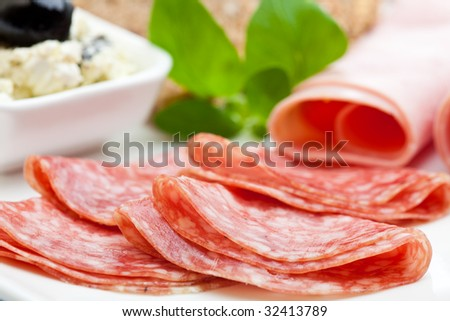 Delicious slices of salami with ham and feta cheese