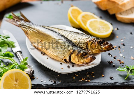 Delicious smoked salmon herring beautifully garnished on a rustic wooden table #1279791625