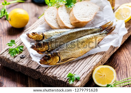 Delicious smoked salmon herring beautifully garnished on a rustic wooden table #1279791628