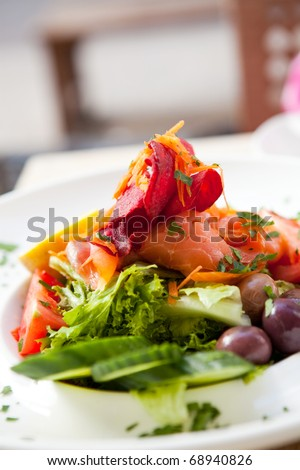 Delicious smoked salmon salad on an outdoor restaurant table
