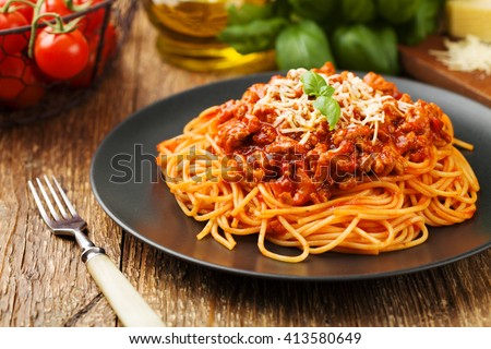 Delicious spaghetti served on a black plate