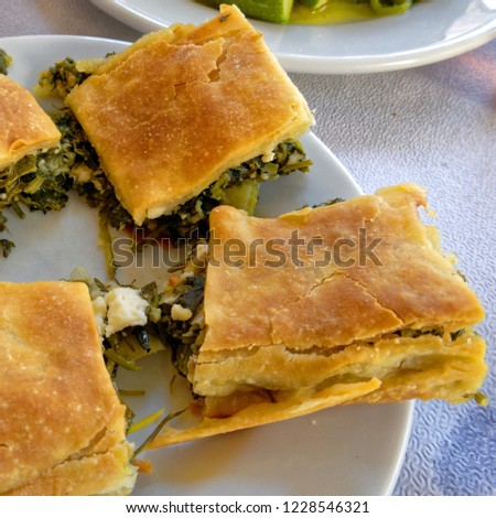 "delicious ""spanakopita"" traditional Greek spinach and feta pie portions close up"