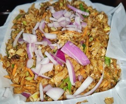 Delicious spicy Sri Lankan chicken kottu for dinner. Asian street food. Sri Lankan kottu dish
