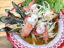 """Delicious spicy Thai food """"papaya seafood salad"""", popular food for diet and healthy"""