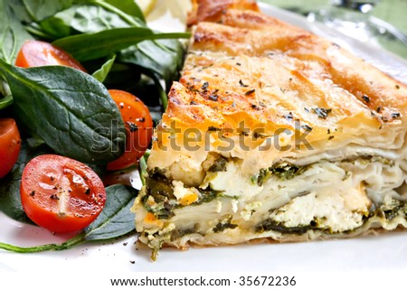 Delicious spinach and feta cheese pie, with filo pastry.  Traditional Greek spanakopita, with salad.