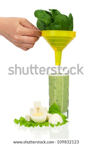 Delicious spinach smoothie on white background