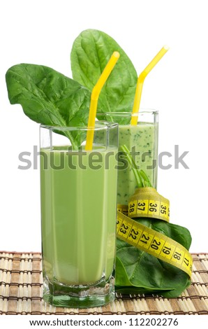 Delicious spinach smoothie with tubule on white background