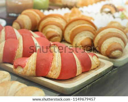 Stock Photo Delicious strawberry flavored croissant. Close up and Selective focus.
