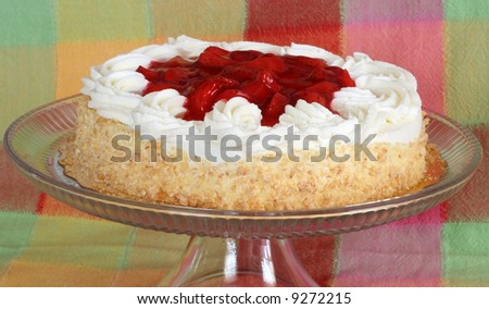 delicious strawberry shortcake on platter with colorful plaid background