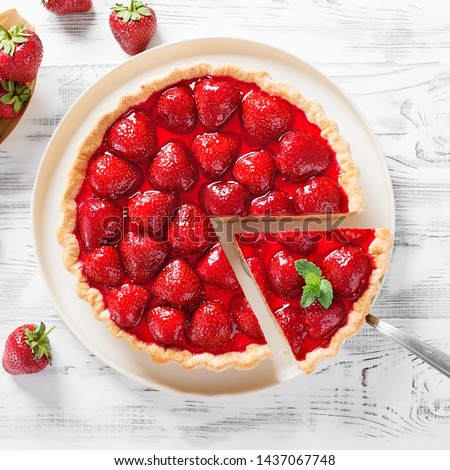 Delicious strawberry tart on white wooden background, top view