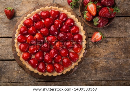 delicious strawberry tart on wooden background, top view, copy space