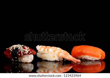 delicious sushi isolated on black