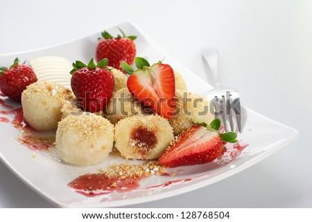 Delicious sweet dumplings stuffed with strawberries