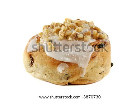 Delicious sweet iced bun with walnuts and coconut.