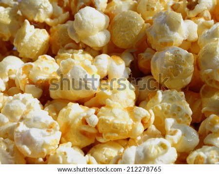 delicious sweet popcorn golden color close up on the outdoor cinema in the afternoon useful for food background