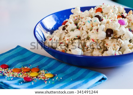 Delicious Sweet Popcorn With Colorful Candies And Sprinkles