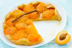 Delicious Tarte Tatin with apricots and vanilla selective focus