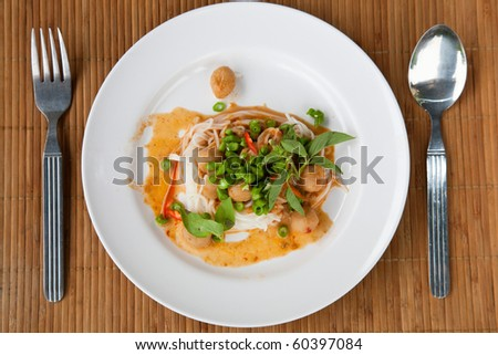 delicious Thai food dish with spoon and fork