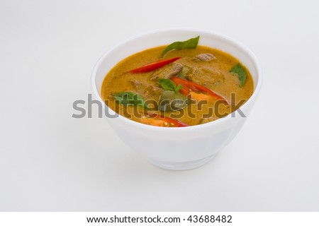 delicious thai food: red curry in a white bowl