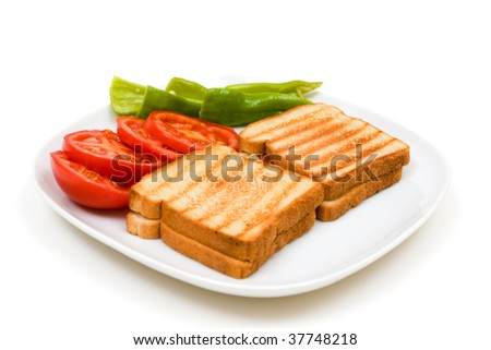 Delicious toasts with sliced tomatoes and green peppers isolated on white background.
