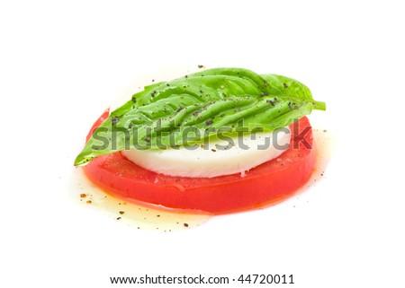Delicious tomato and mozzarella salad over white background