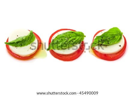 Delicious tomato and mozzarella salad over white background