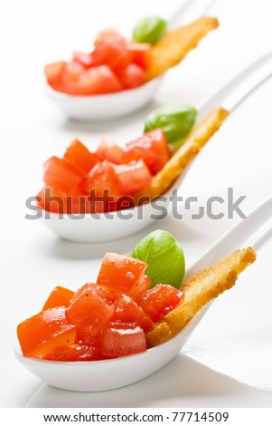 Delicious tomato bruschetta served in appetizer spoons