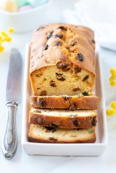 Delicious traditional fruitcake with raisins and candied fruit. Sliced plumcake with glaced fruit