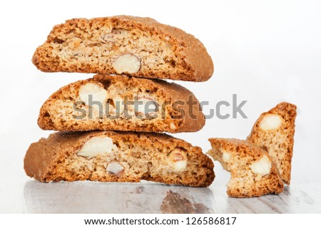 Delicious traditional italian cookie cantuccini detail on white wooden textured background. Culinary sweet dessert eating.