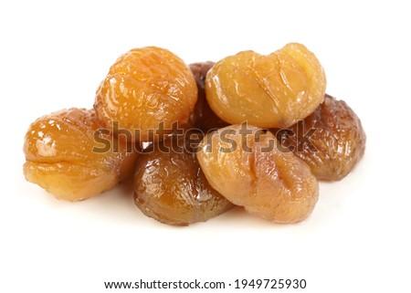 Delicious Turkish candied chestnut  ( Kestane Sekeri ) or marron glace. Isolated on white background. Photo stock ©