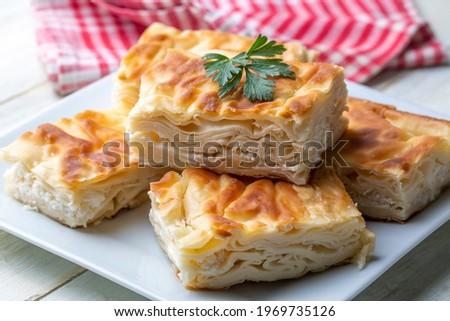 Delicious Turkish food; Tray pastry; (Turkish name; Su boregi) Stok fotoğraf ©