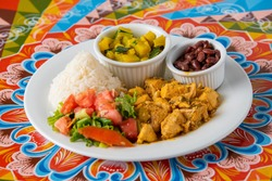 Delicious typical Costa Rican lunch on a colorful table of the Costa Rican cart