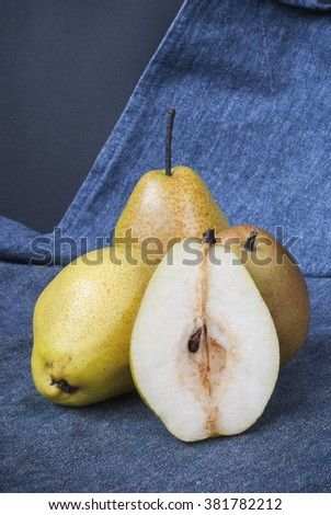 Delicious washed pears on a blue fabric. Selective focus. #381782212