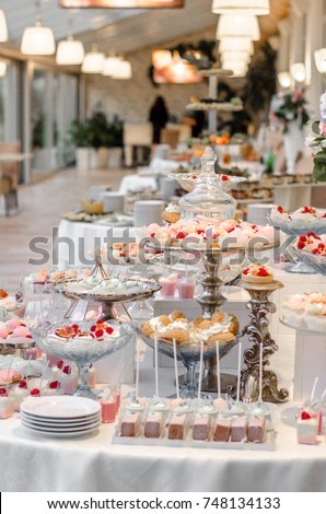 Delicious wedding reception candy bar dessert table full with cakes ...