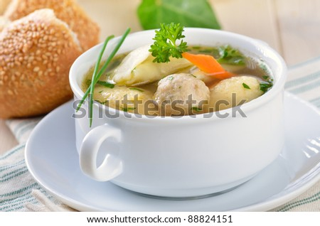 Delicious wedding soup with semolina dumplings, bone marrow dumplings and stuffed ravioli