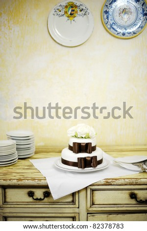 stock photo Delicious white and brown wedding cake