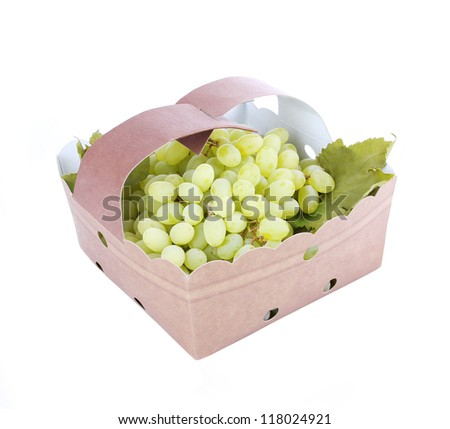 delicious white grapes in basket isolated on white