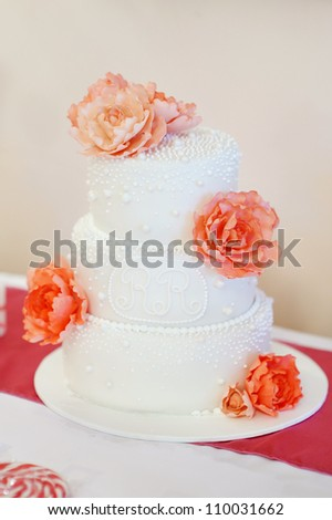 Delicious white wedding cake decorated with peonies