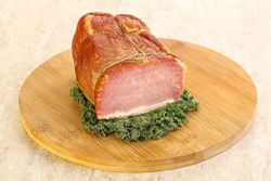 Delicous pork cured meat isolated over board